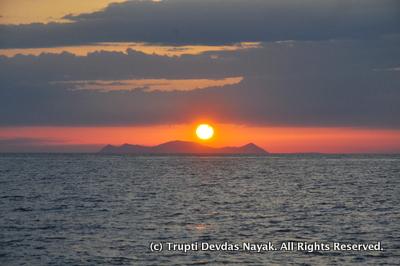 Santorini sunset from cruising sailboat Thalassa